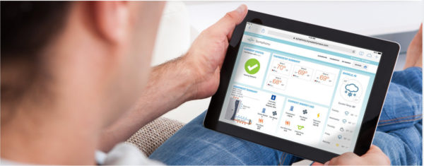 man holding tablet looking at symphony dashboard