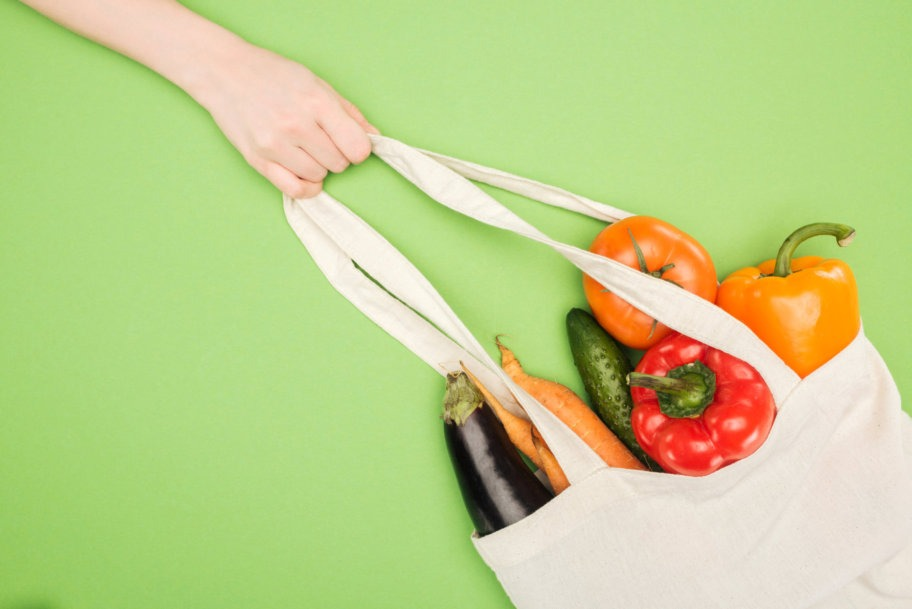 white eco friendly grocery bag in hand
