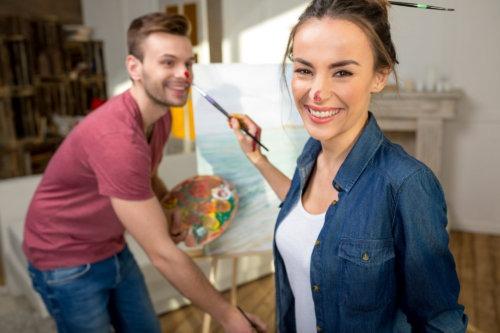 couple having fun painting